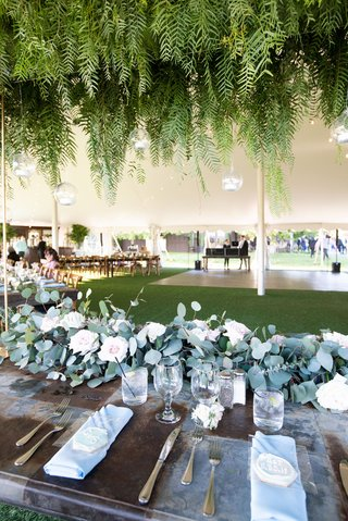 echosmith-singer-sydney-sierota-and-cameron-quiseng-wedding-reception-eucalyptus-wood-table-ferns