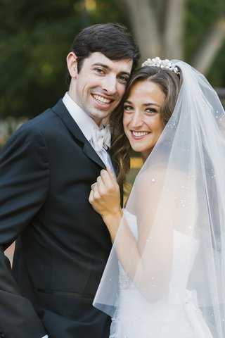 woman-in-sparkling-veil-and-man-in-tuxedo