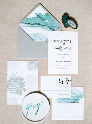 grey-envelope-with-teal-envelope-liner-and-invitation-minted-with-palm-leaf-print-calligraphy