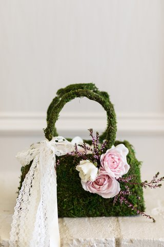 moss-flower-girl-purse-basket-with-pink-flowers-and-a-lace-bow
