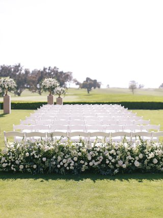 wedding-ceremony-at-the-lodge-at-torrey-pines-greenery-white-flowers-white-chairs-outdoor-wedding