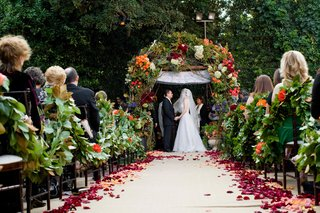 bride-and-groom-at-end-of-outdoor-wedding-aisle