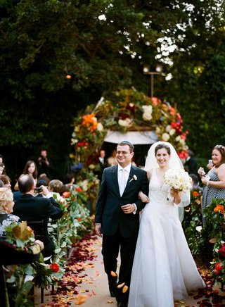 bride-and-groom-walk-up-garden-ceremony-aisle