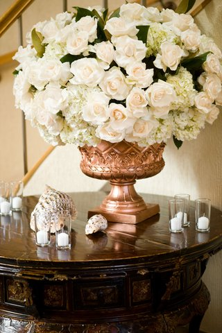 wedding-reception-copper-urn-with-seashells