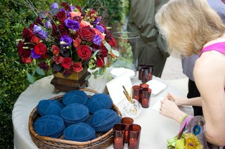 garden-jewish-ceremony-yarmulkes-on-table