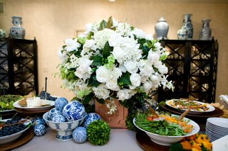 white-flower-arrangement-with-fruit-and-cheese-plates
