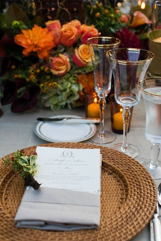 wedding-reception-table-with-wicker-charger-plate