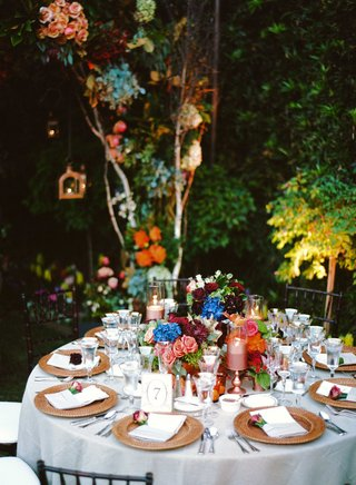 round-reception-table-with-colorful-flower-centerpieces