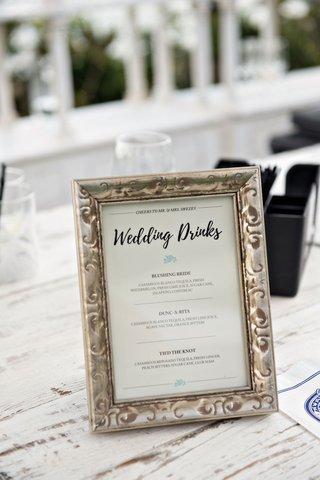 wedding-drinks-menu-on-whitewash-wood-bar-with-antique-frame-casamigos-tequila-bar-menu-ideas
