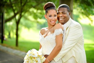 megan-wollover-in-high-bun-and-off-the-shoulder-ines-di-santo-wedding-dress-and-tracy-morgan-wedding