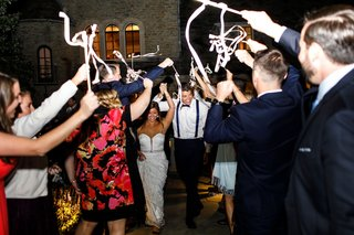 wedding-reception-grand-exit-send-off-ribbon-wands-with-bells-guests-waving-send-off