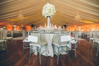 sequined-tablecloths-and-chandelier-lighting