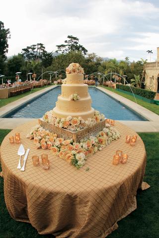 wedding-cake-surrounded-by-orange-and-white-flowers