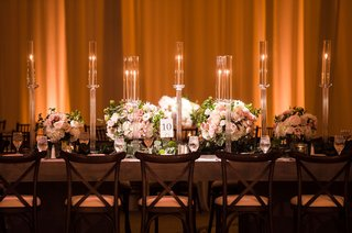 wedding-reception-low-centerpiece-tall-candles-candleholders-taper-candle-rectangular-tables