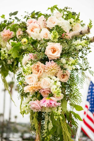 ceremony-arch-with-amaranthus-peach-blush-and-ivory-flowers-heavy-greenery-birch-branched
