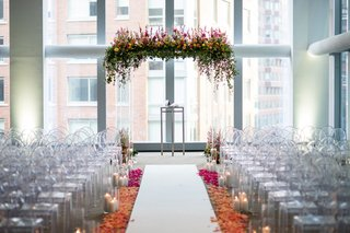 indoor-hotel-wedding-ceremony-white-aisle-ombre-flower-petal-aisle-lucite-chuppah-with-flowers-top