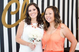 bride-in-white-dress-and-coral-necklace-white-rose-bouquet-at-bridal-shower