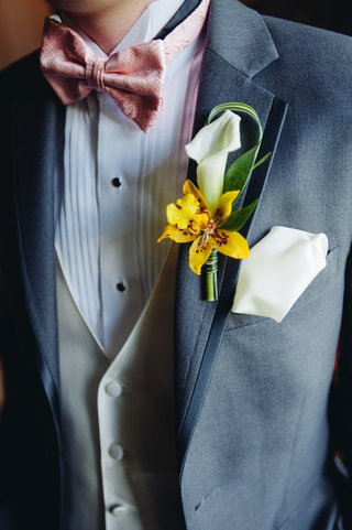 groomsman-in-three-piece-suit-with-flowers-and-pocket-square