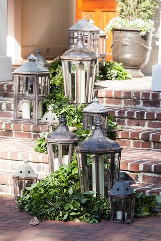 outdoor-wedding-reception-brick-steps-montage-palmetto-bluff-lanterns-and-green-garlands-decorations