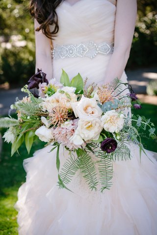 loosely-structured-bridal-bouquet-with-fern-eucalyptus-dark-plum-blush-ivory-blossoms