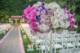 ceremony-flower-arrangement-on-top-of-lucite-stand-purple-orchid-purple-rose-purple-lisianthus