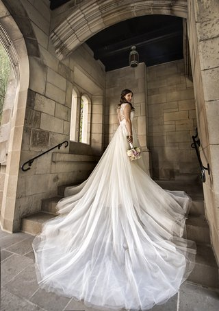 hayley-paige-wedding-dress-a-line-gown-with-long-tulle-train-cascading-over-steps