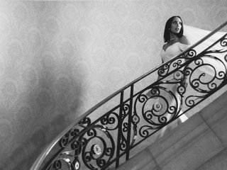 black-and-white-photo-of-cheryl-burke-dancing-with-the-stars-on-staircase-in-wedding-dress