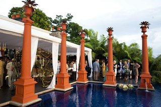 guests-mingling-around-orange-pillars-by-pool
