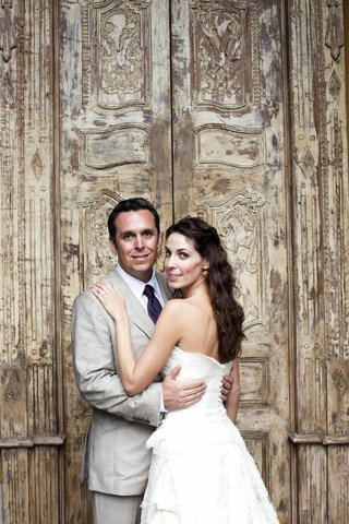 newlyweds-in-front-of-large-door-in-costa-rica