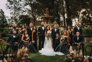 bride-and-groom-with-bridesmaids-in-black-dresses-and-groomsmen-ring-bearer-stephanie-perez