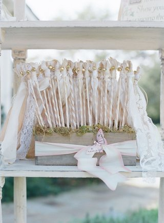 wood-box-on-bookshelf-with-lace-vintage-ribbon-wands-for-ceremony-kiss
