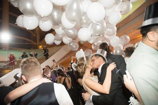 bride-and-groom-kissing-on-nye-dance-floor
