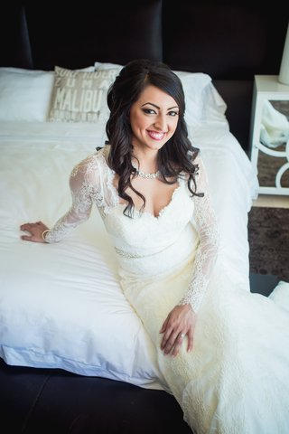 hairstyle-bridal-dark-hair-curly-lace-dress-getting-ready-portrait