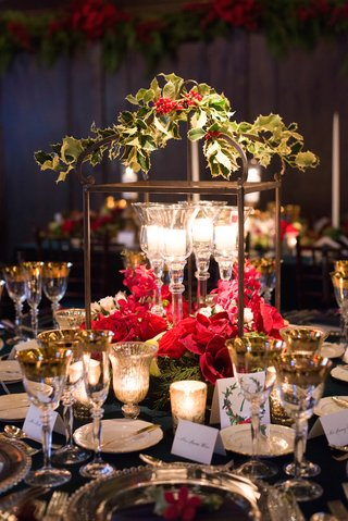 candles-in-crystal-candleholders-with-holly-greenery-and-red-flowers