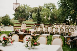 wedding-reception-decor-french-upholstered-chair-with-low-centerpiece-cocktail-tables-lounge