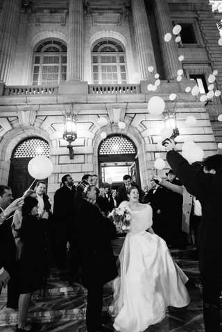 black-white-photo-reception-grand-exit-bride-in-fur-wrap-balloon-release-reception-inspiration-ideas