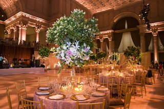 ballroom-wedding-with-green-tree-centerpiece-and-gold-decorations