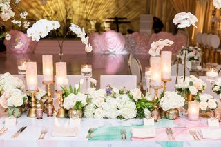 wedding reception head table flower print vinyl on lacquer head table candles hydrangea orchid