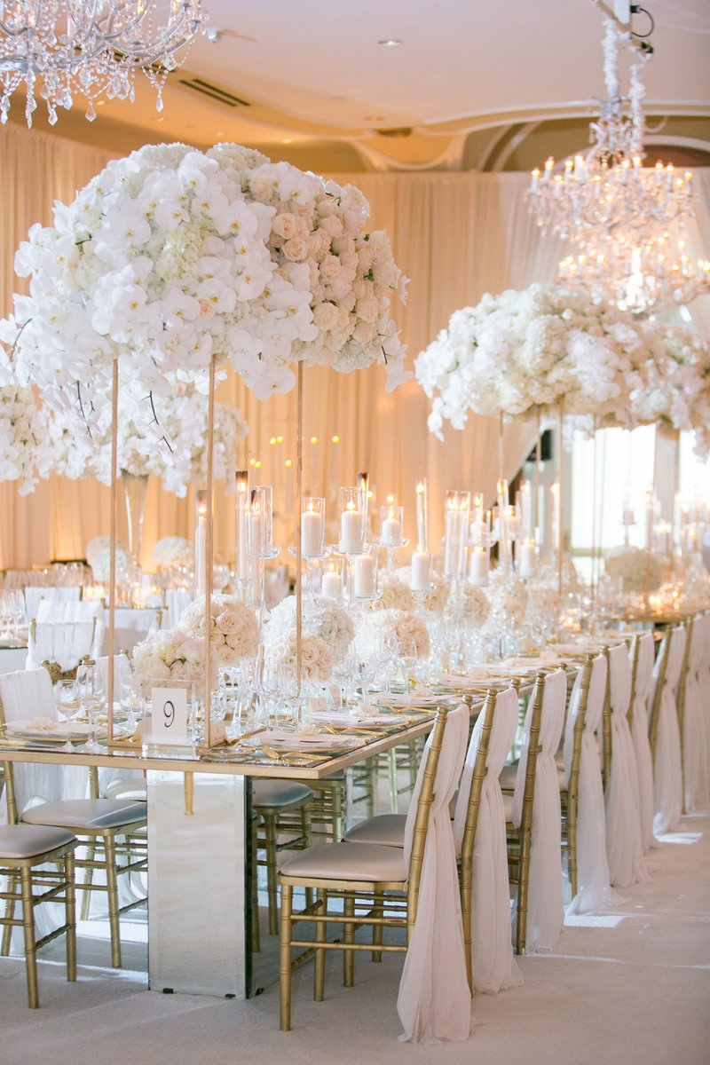 Crystal Chandeliers and Tall Floral Arrangements