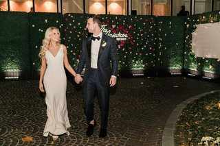 bride-and-groom-walking-away-from-wedding-neon-sign-v-neck-dress-long-blonde-hair