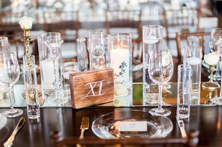 wedding-reception-wood-table-with-mirror-runner-candles-wood-block-table-number-roman-numeral