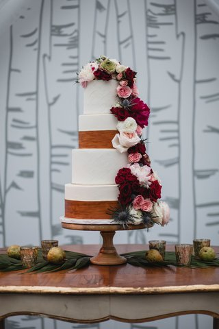 wedding-cake-with-wood-trim-design-and-fresh-flowers-fall-colors-on-wood-vintage-table-birch-branch