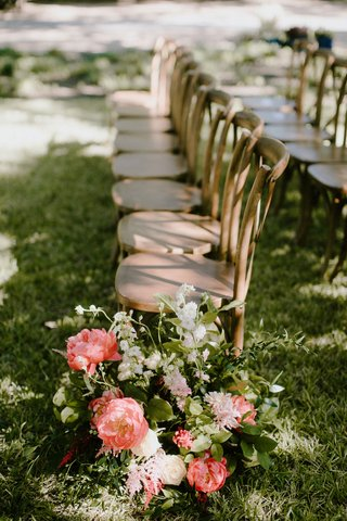 outdoor-wedding-ceremony-wood-vineyard-x-back-chairs-grass-flower-arrangement-pink-peony-flowers