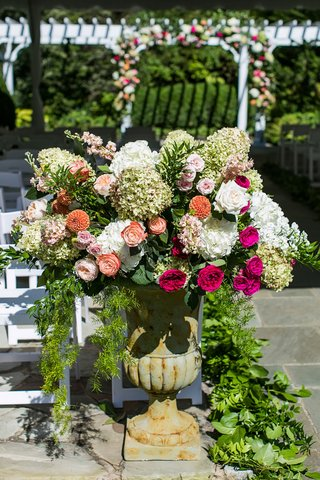 wedding-ceremony-decor-stone-urn-with-greenery-pink-orange-white-flowers-rose-hydrangea-blooms