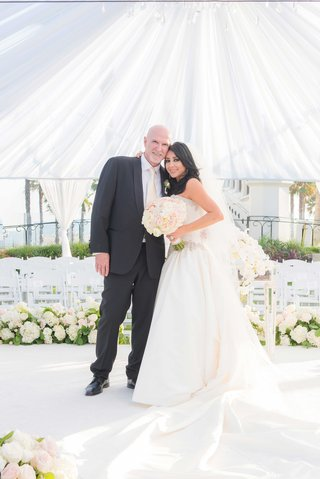 bride-and-groom-vow-renewal-tenth-wedding-anniversary-party-white-tent-blush-ivory-color-palette
