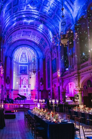 wedding-reception-venue-high-arch-ceiling-former-chapel-cathedral-long-tables-candelabra-lights