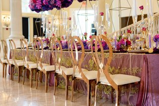 gold-mirrored-chairs-with-looped-backs-at-opulent-wedding