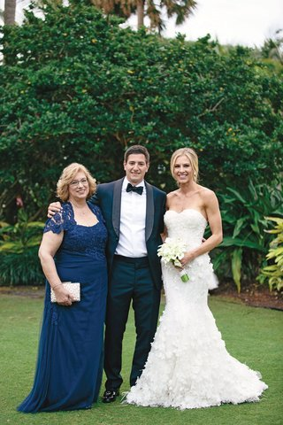 bride-in-strapless-mermaid-marchesa-gown-with-sweetheart-neckline-mother-of-the-groom-in-blue