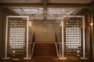 escort-cards-on-calla-lilies-on-lucite-wall