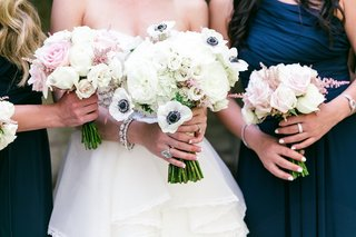 bridal-bouquet-of-ivory-hydrangreas-roses-peonies-and-anemones-with-dark-blue-centers
